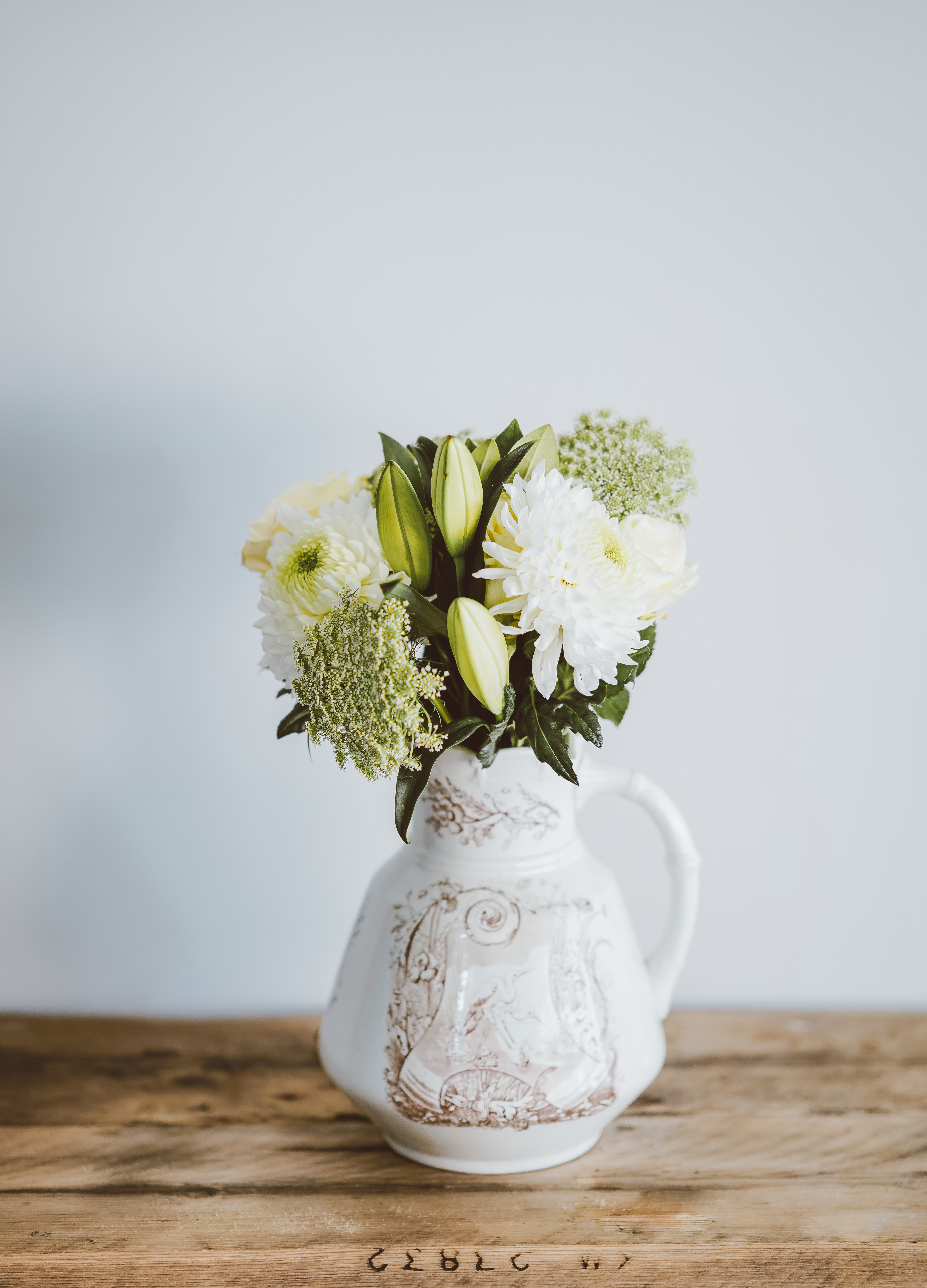 flowers in pitcher vase