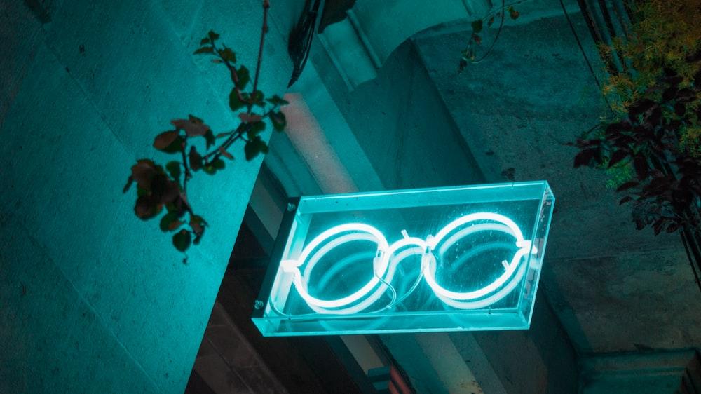white hippie glasses neon light decor on door