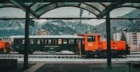 orange train on rail
