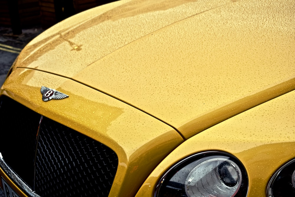 yellow Bentley car