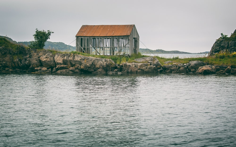 gray house near body of water