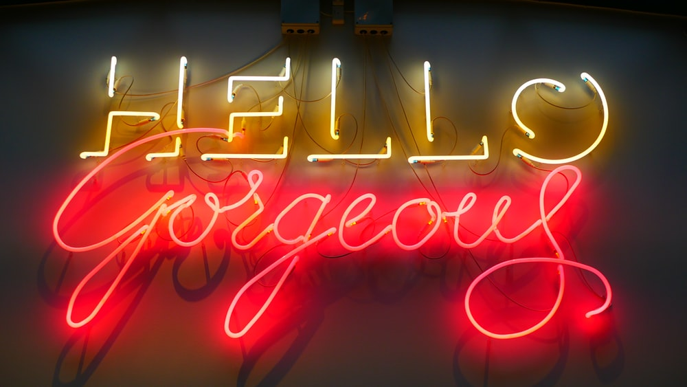 yellow and red hello gorgeous neon light signage