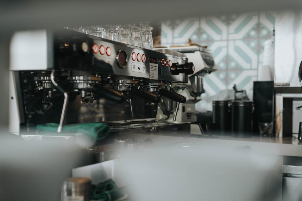 shallow focus photography of gray espresso machine