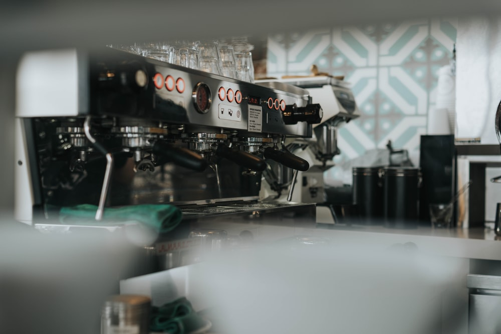 shallow focus photography of gray espresso machine