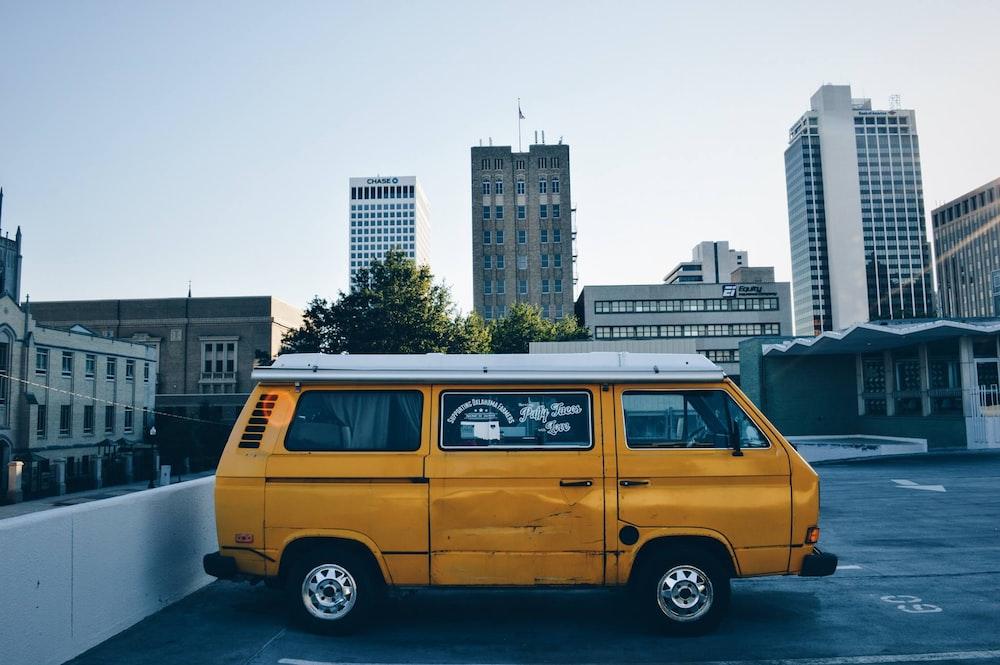 yellow van on parking lot