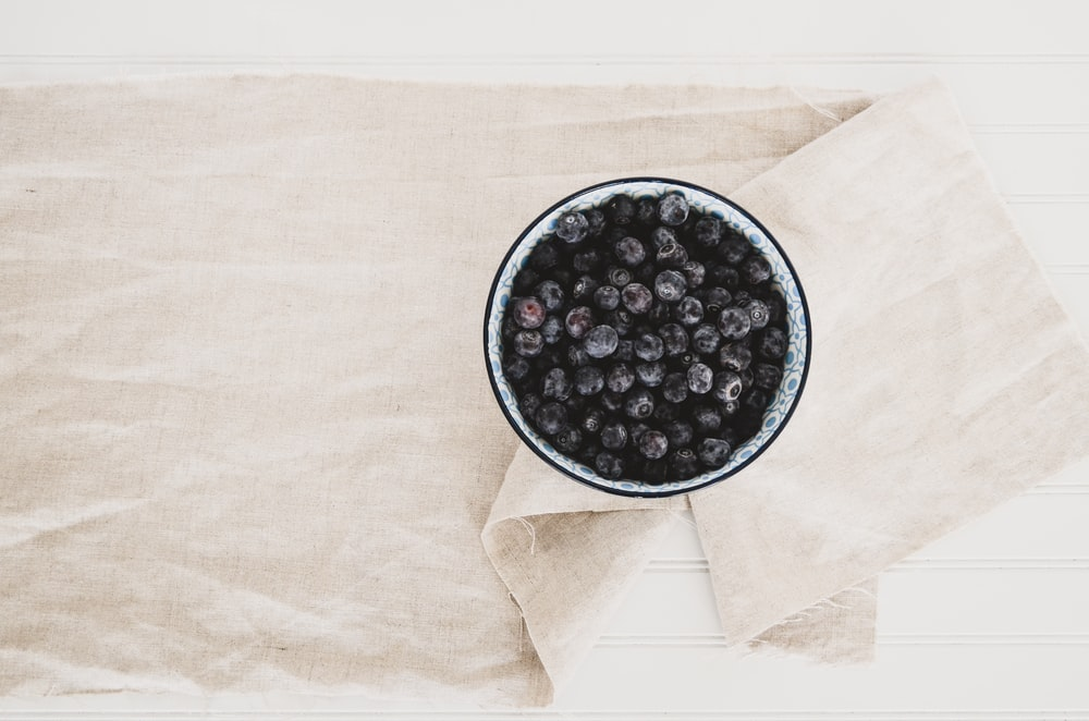 blueberries on gray and black container