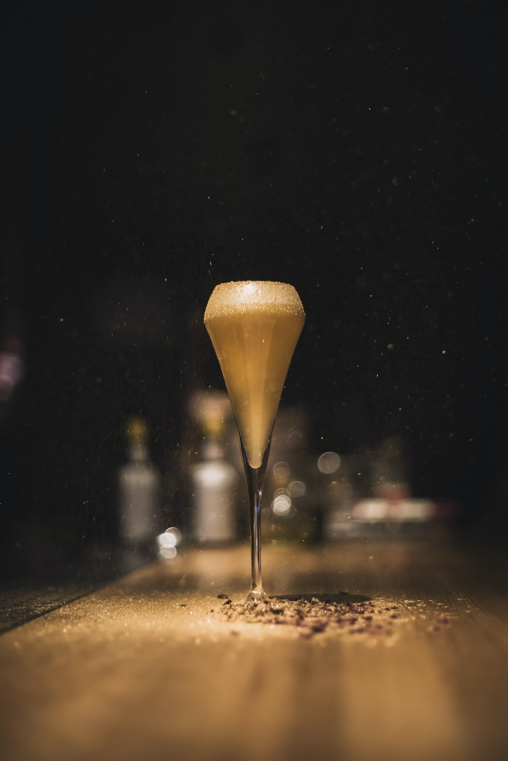 selective focus photography of clear champagne glass