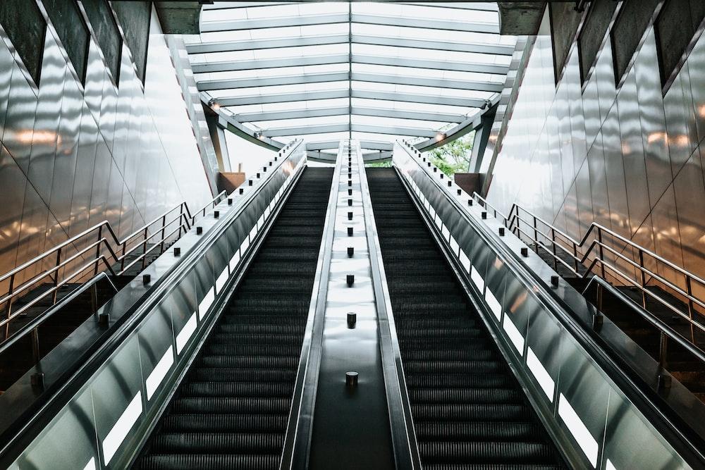 low angle photography of escalator