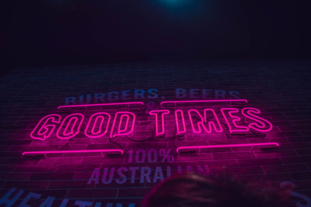 selective focus photography of pink good times neon light signage