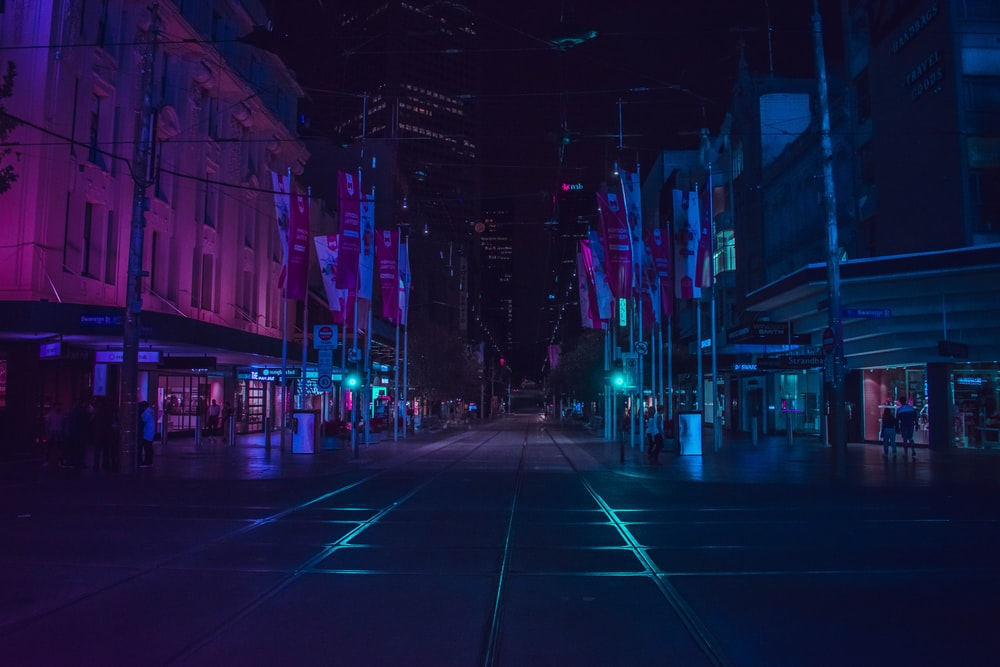 people walking on walkway during nighttime