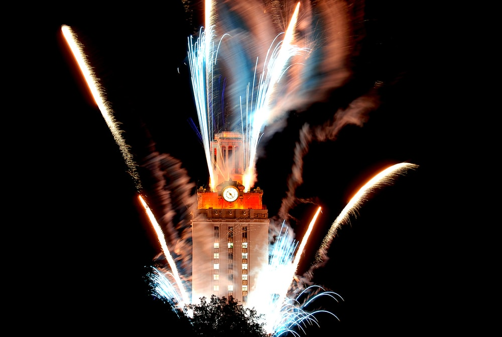 brown and orange clock tower in time lapse photography