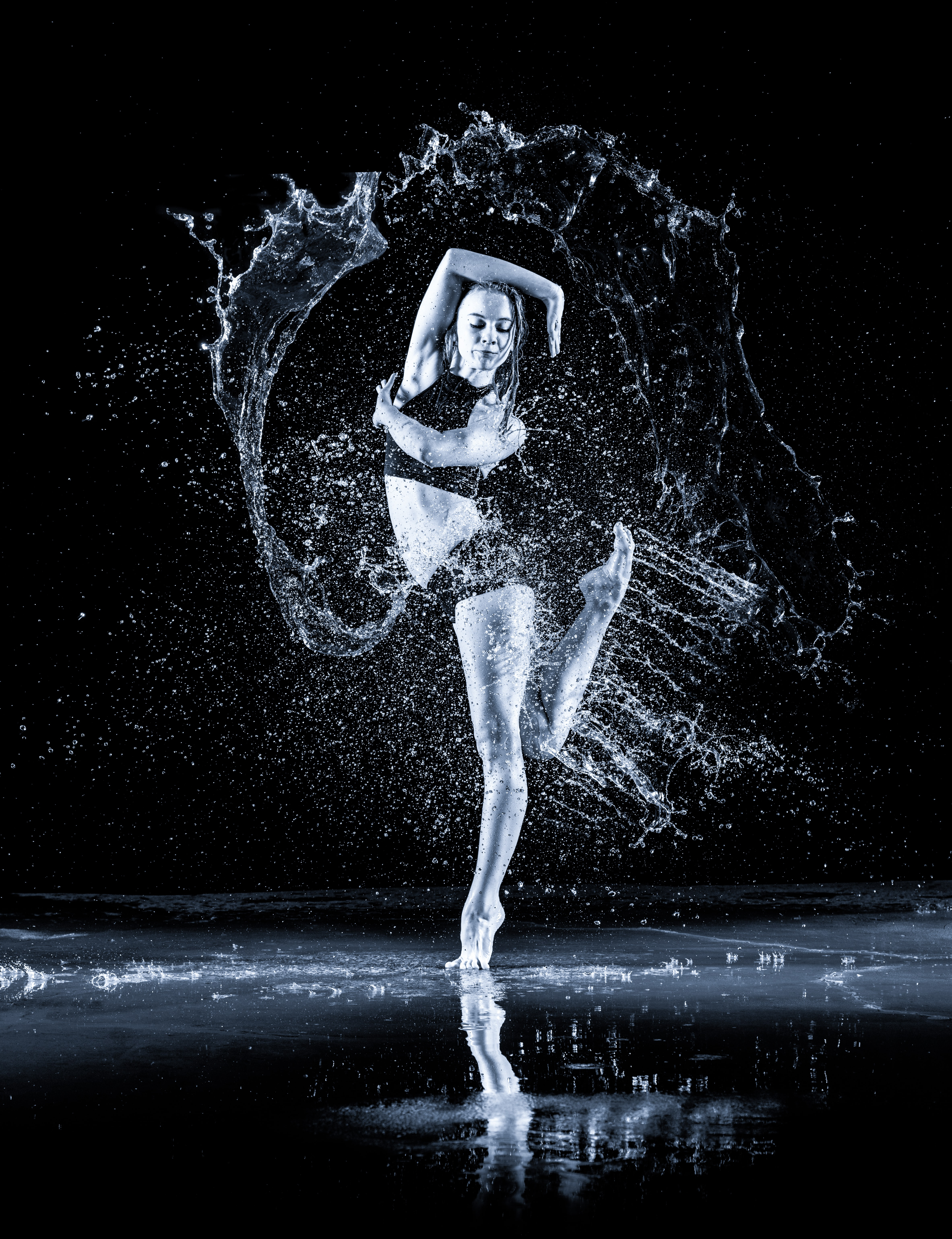 woman dancing with water splashing