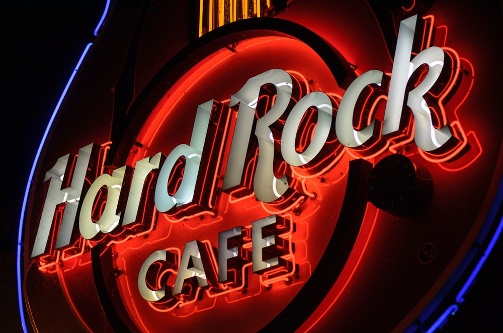 red and black Hard Rock Cafe neon signage