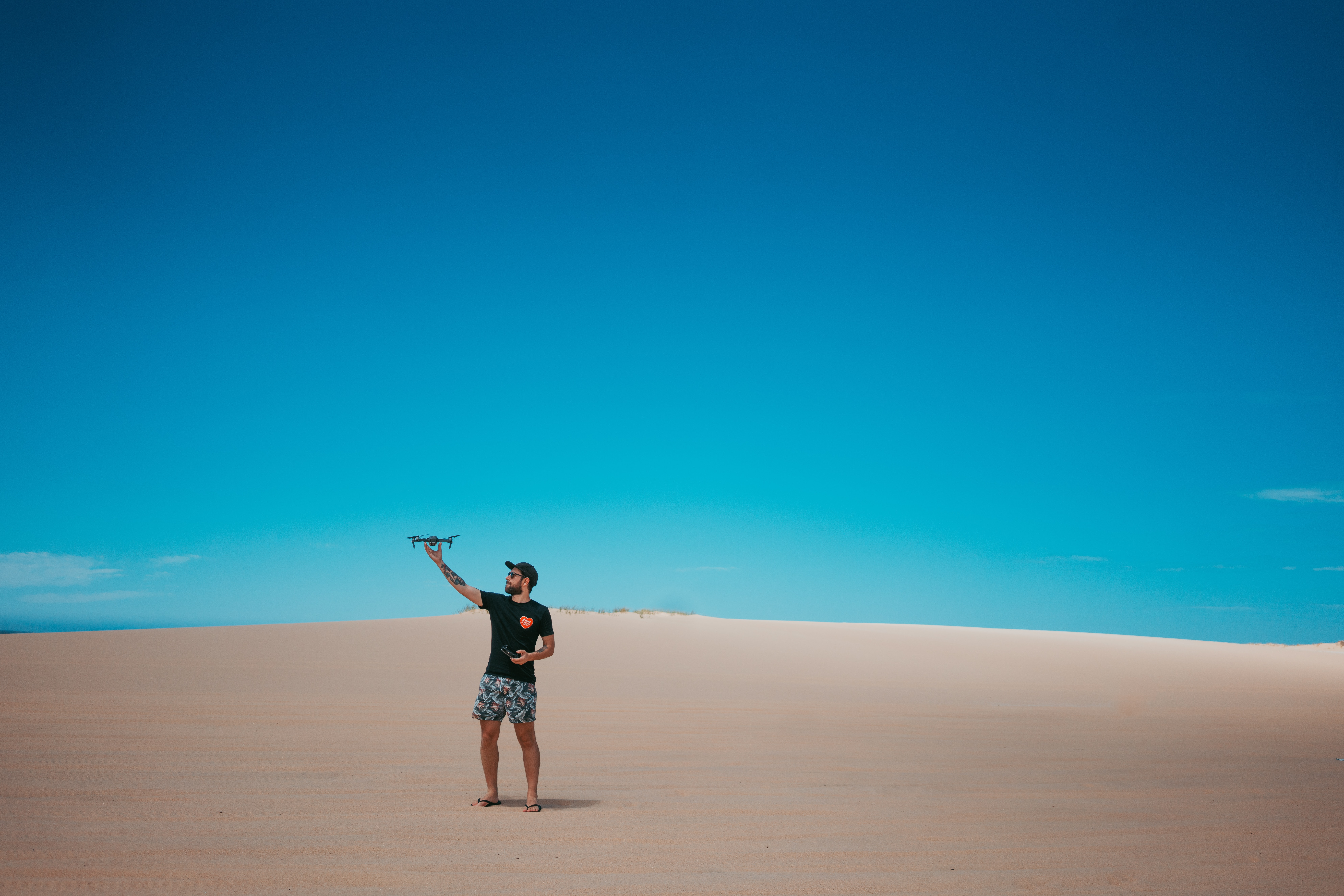 person standing on sand during daytime