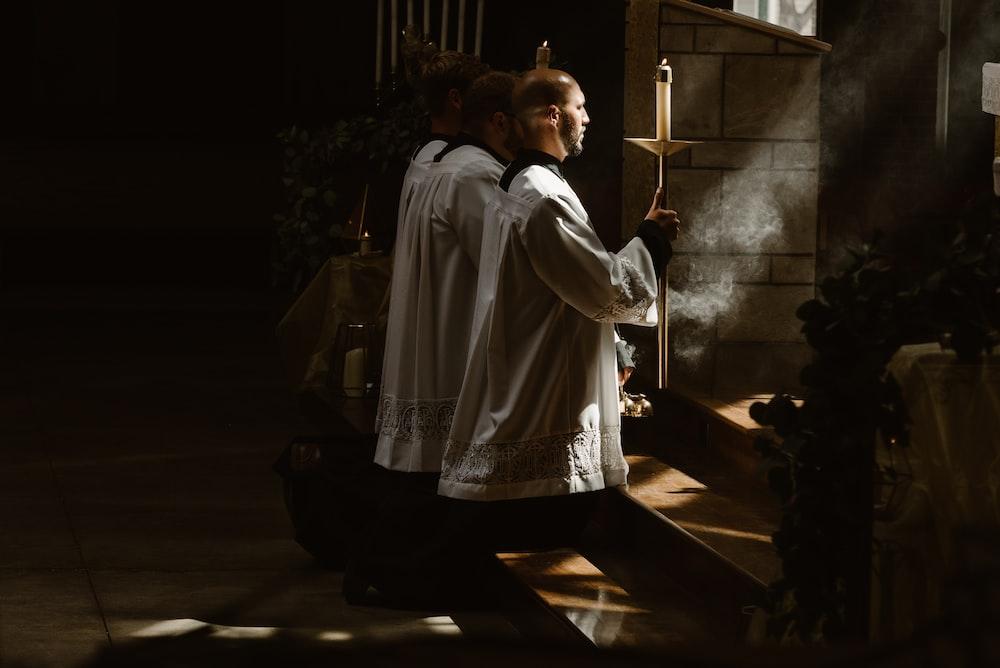 two man worshiping god during daytime