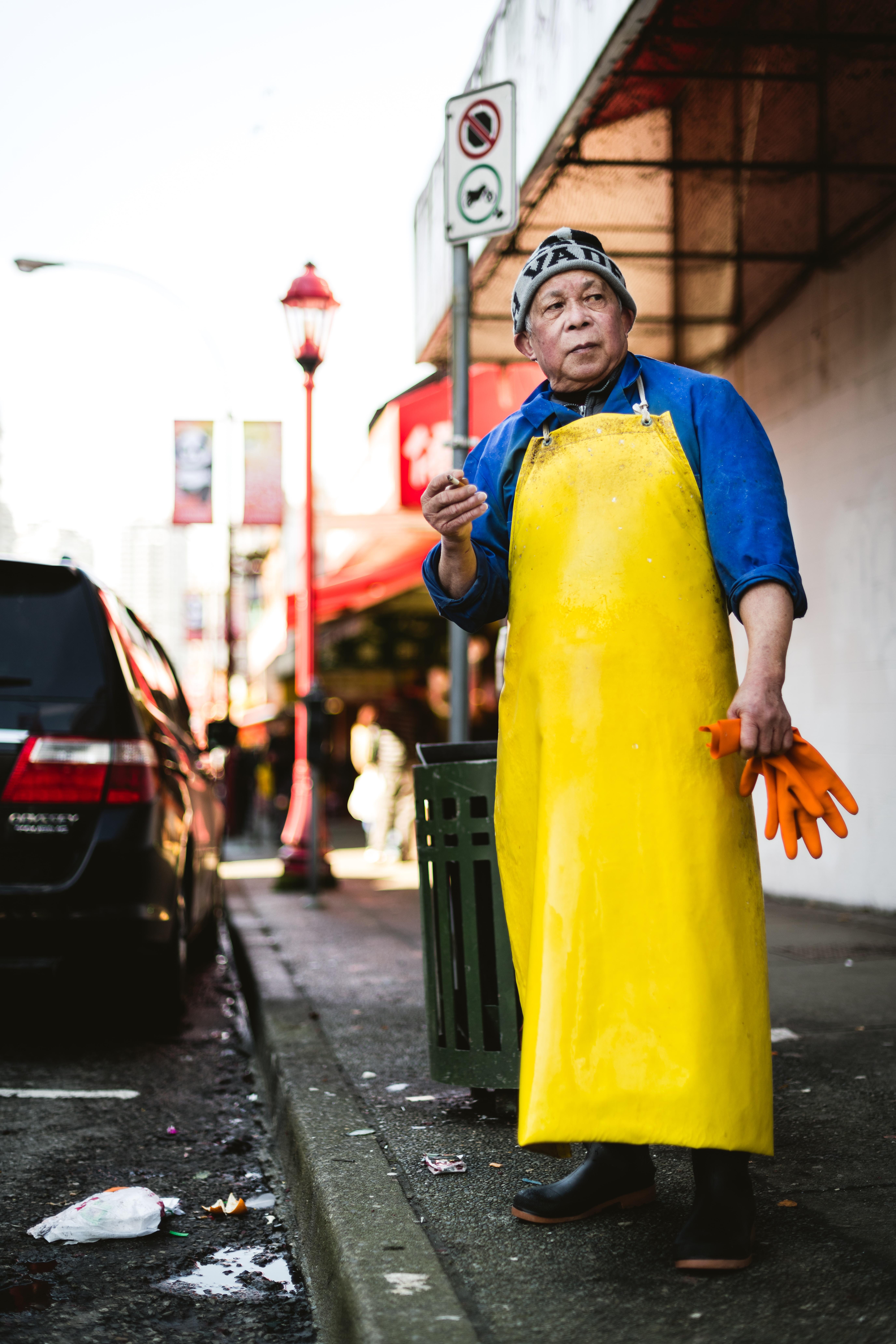 man standing beside a road