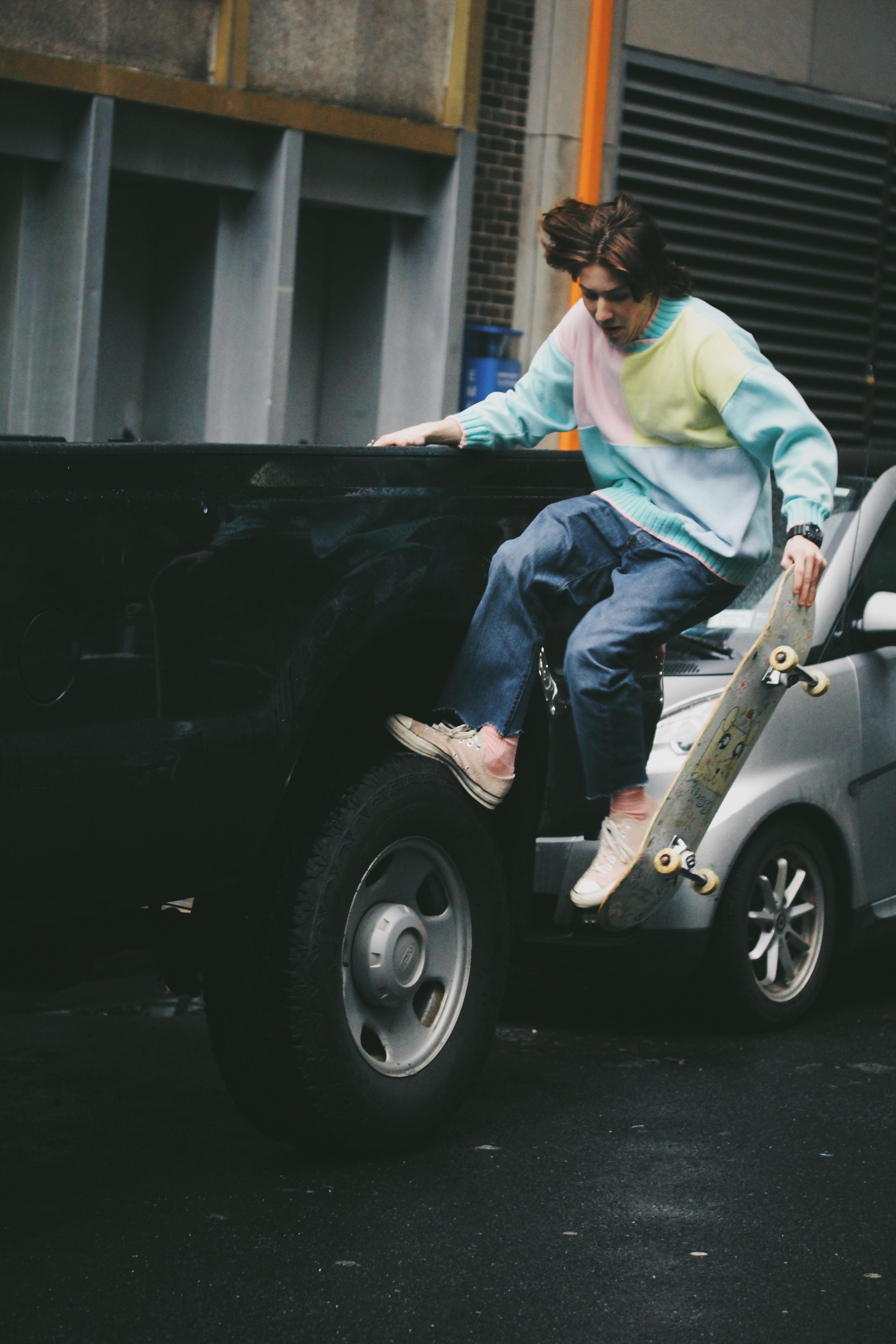 man skateboarding on truck