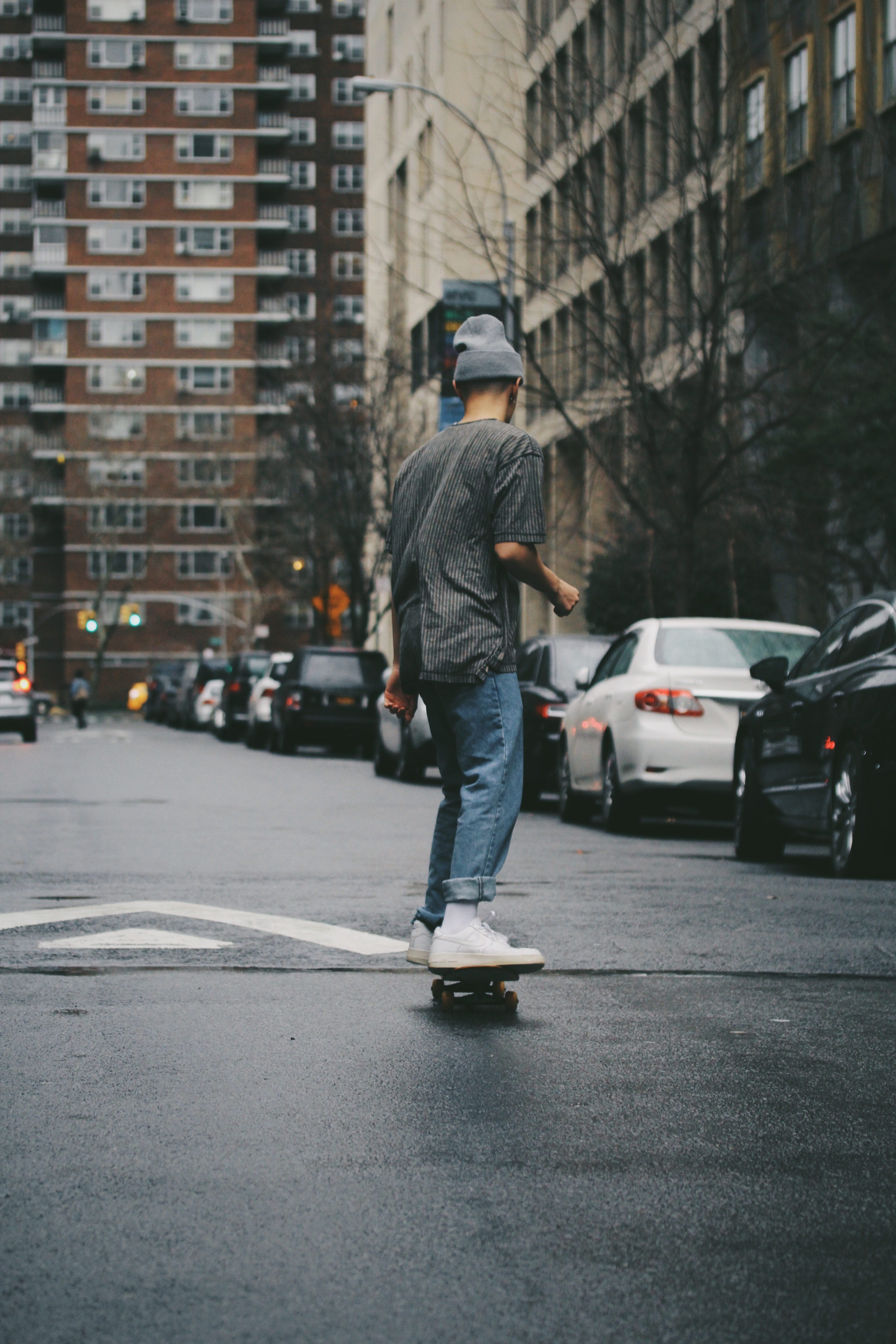 man riding skateboard near high rise building