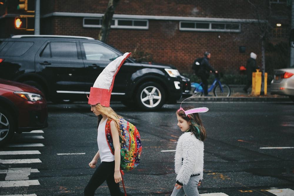 children walking on sidewalk during daytime