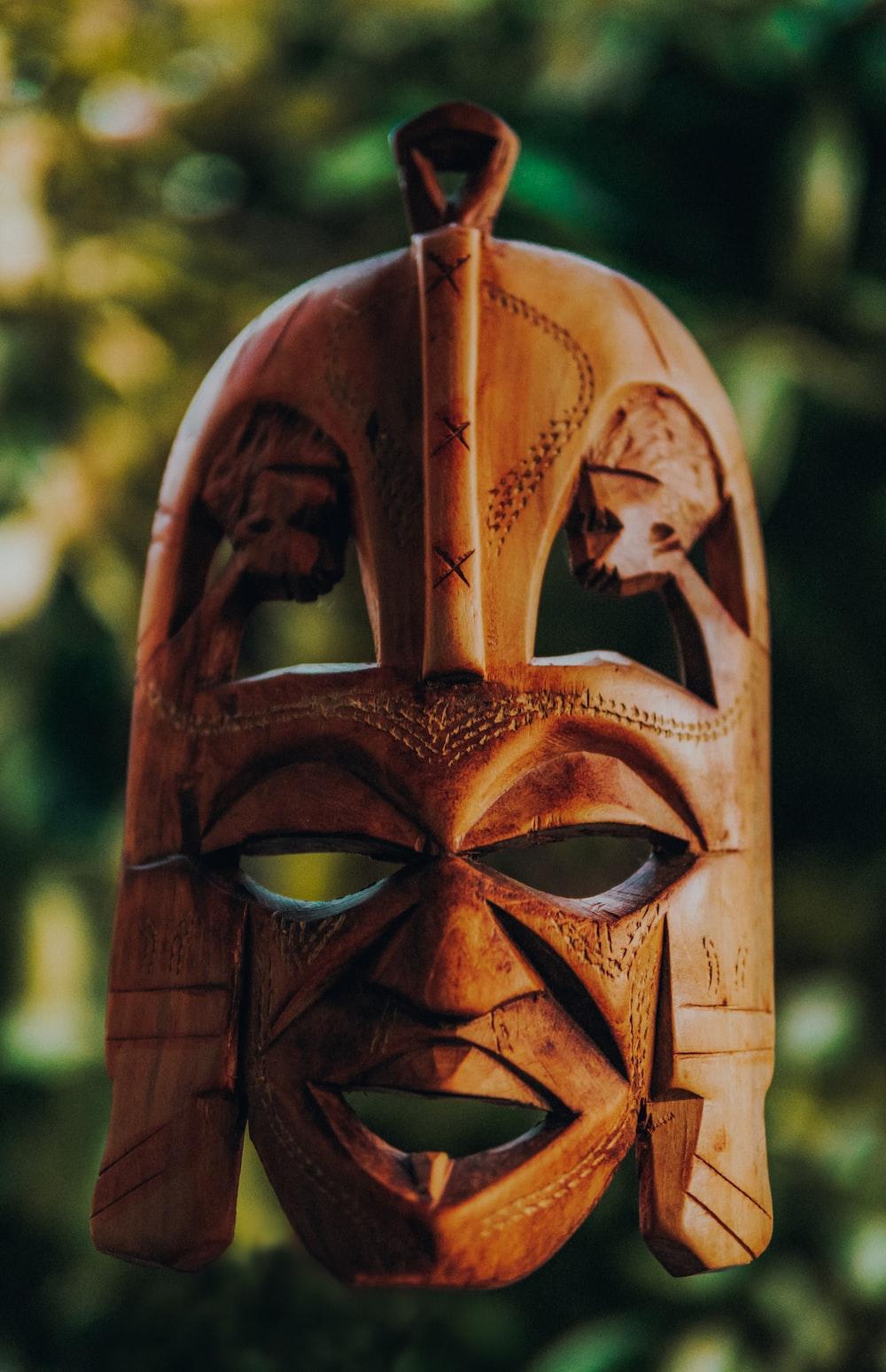 tilt shift lens photography of brown wooden mask