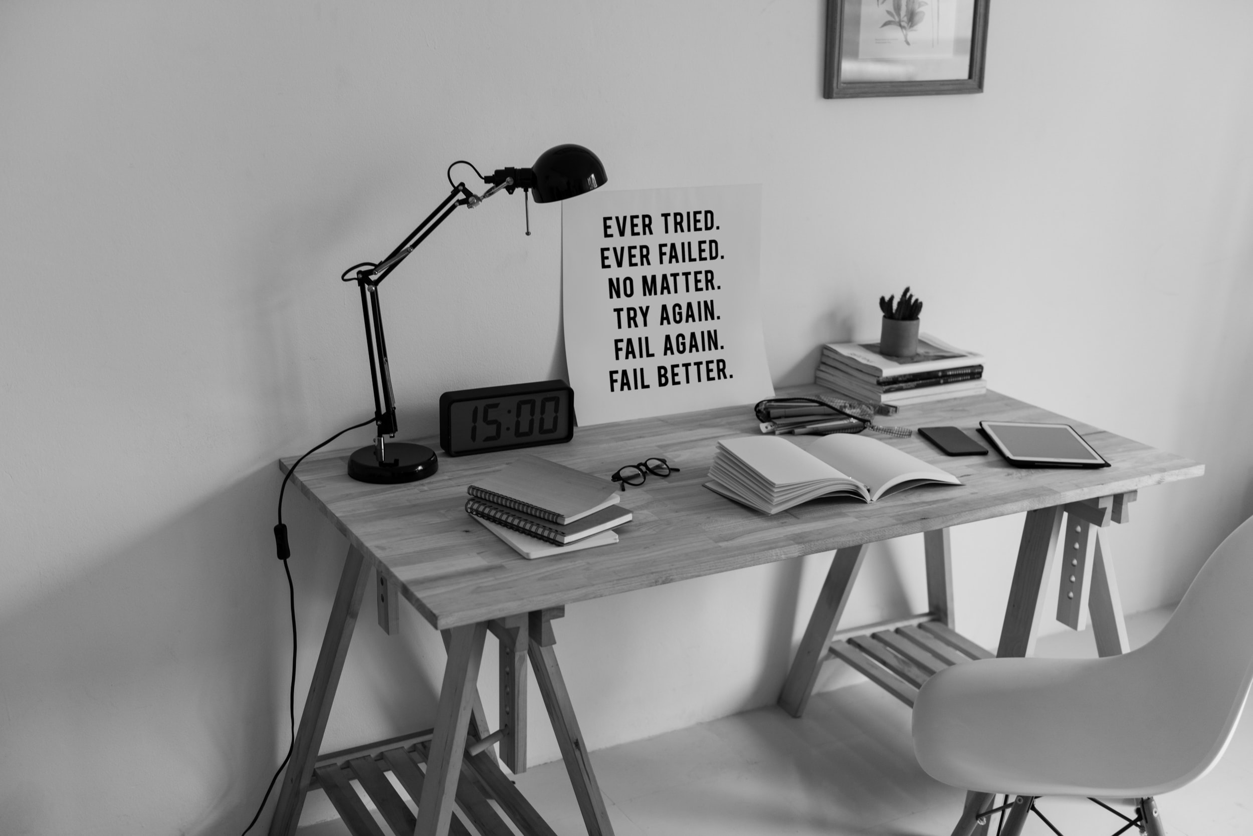grayscale photography of clock at 15:00 on desk