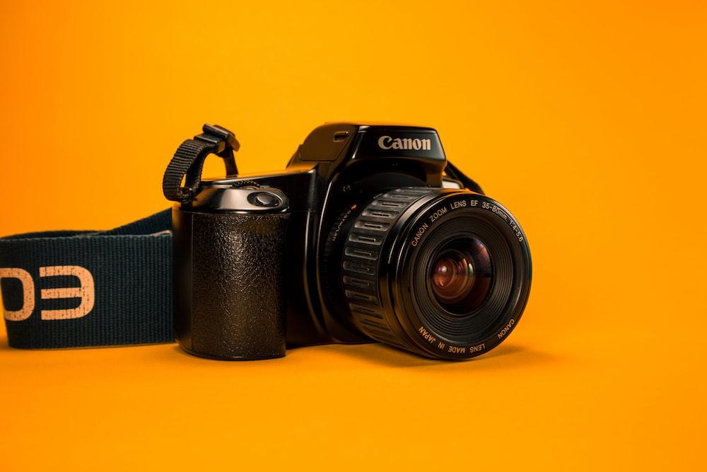 selective focus photography of Canon DSLR Camera