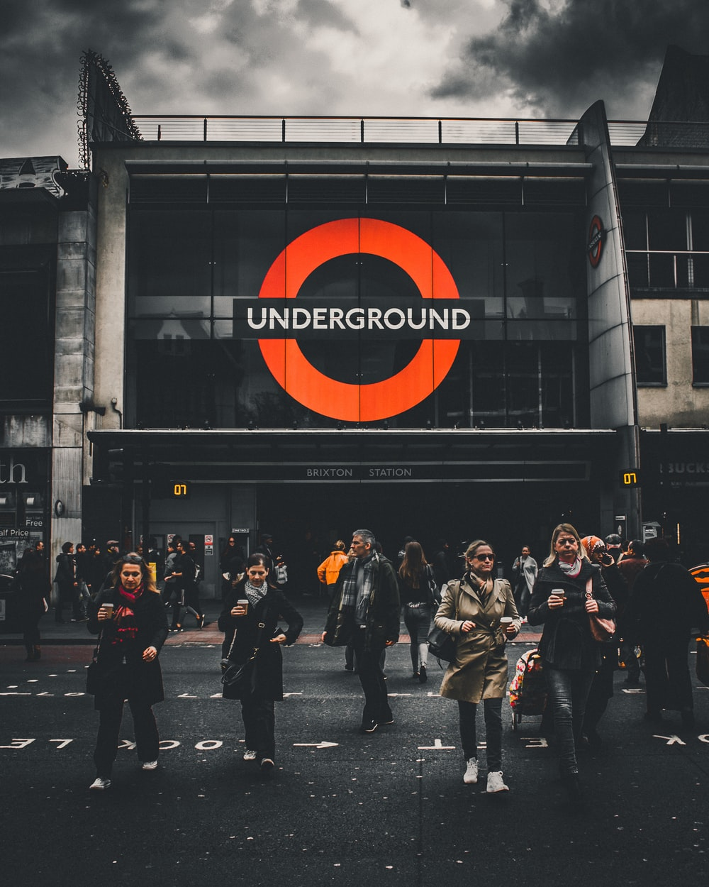 people walking in front of Underground labeled building