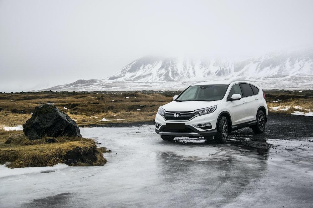 white Honda SUV on gray floor