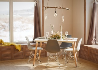 white wooden dining table set during daytime