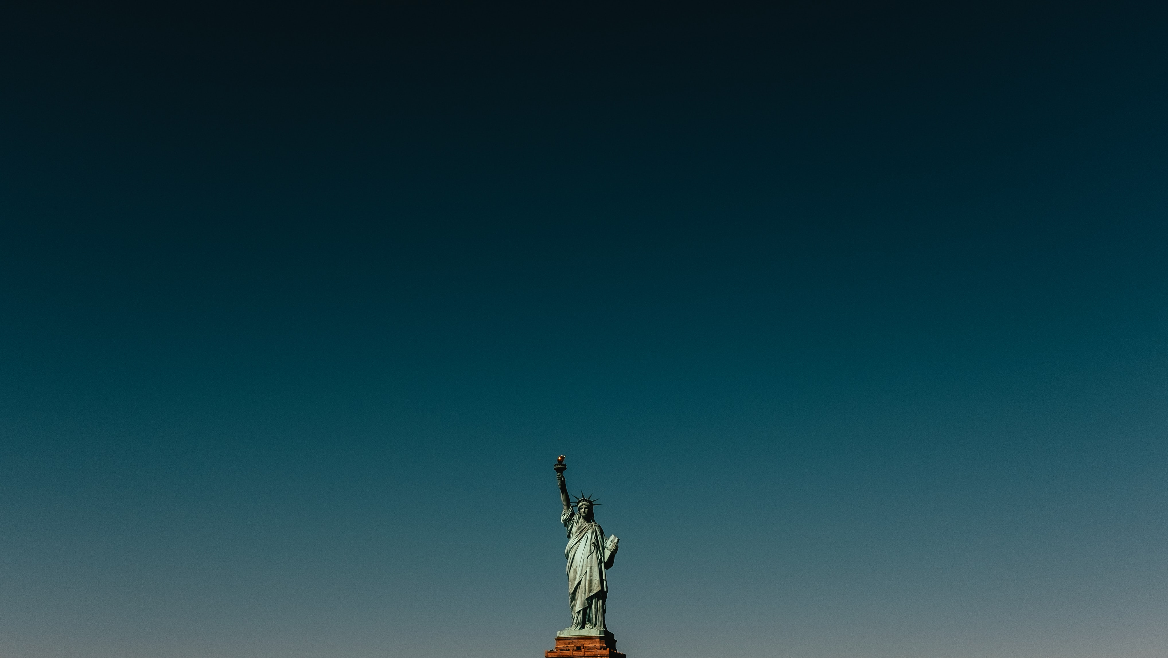 statue of liberty under clear sky