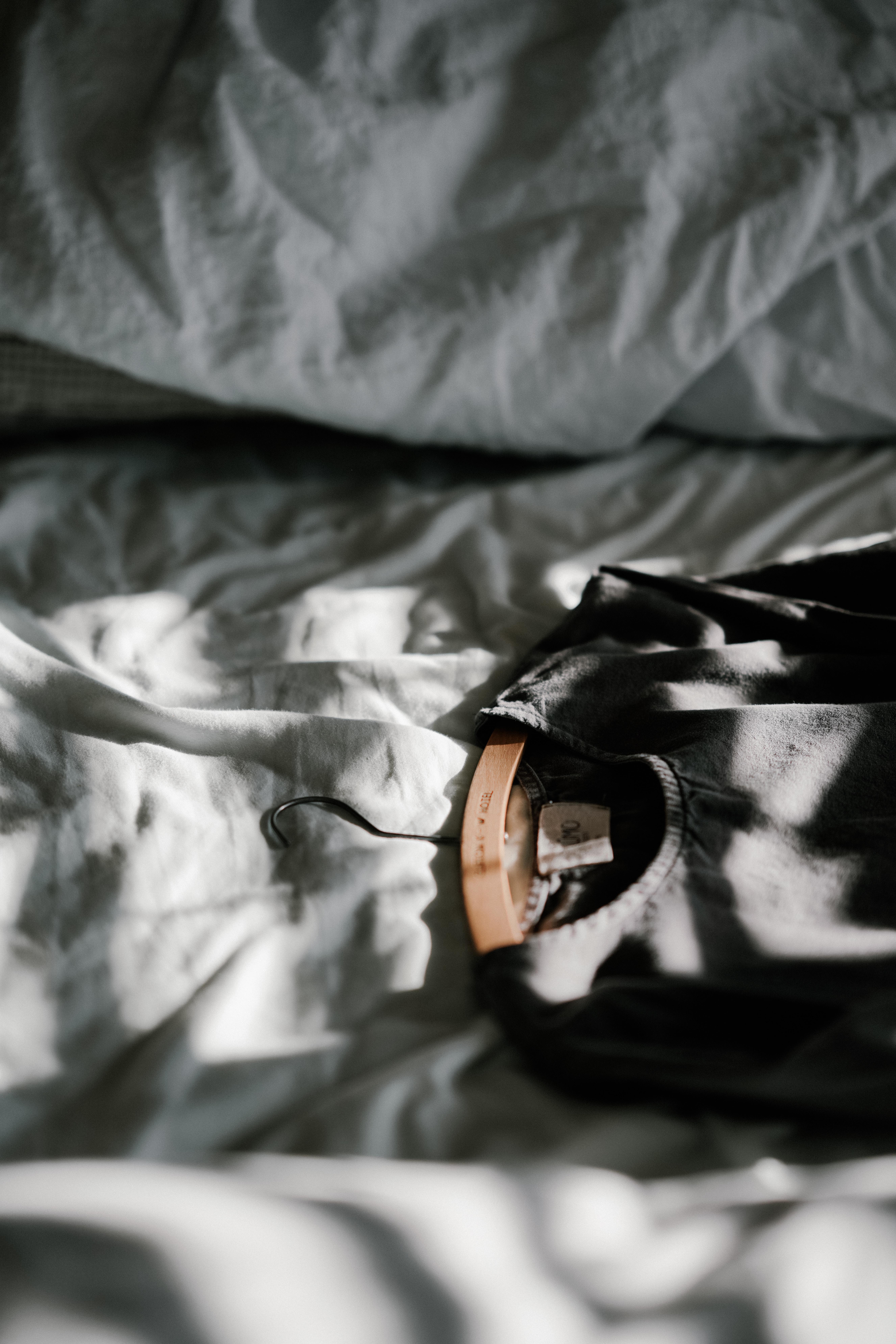 black scoop-neck top on white textile