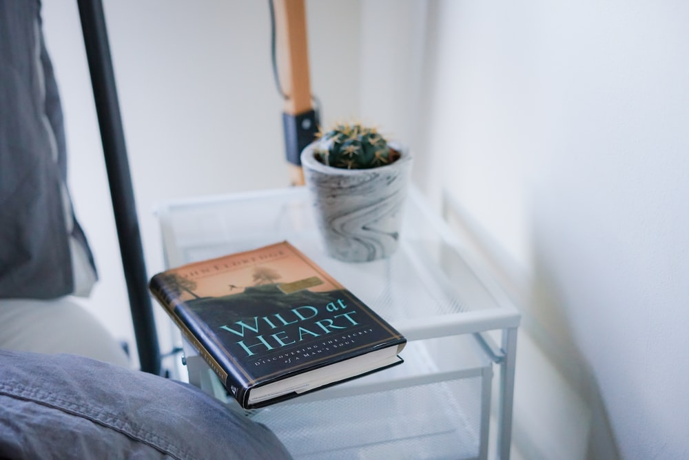 Wild At Heart book on white nightstand
