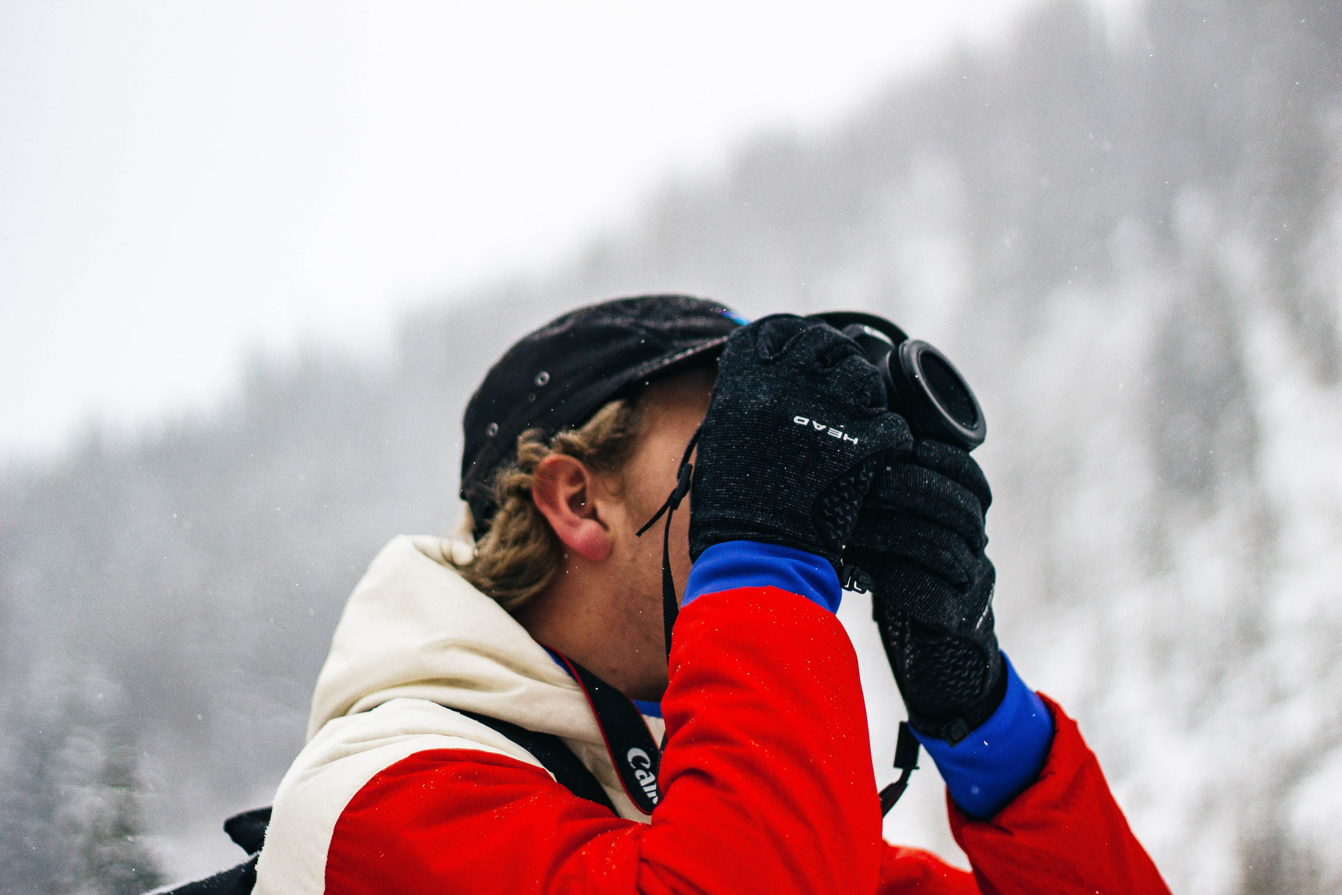person holding camera on snow field