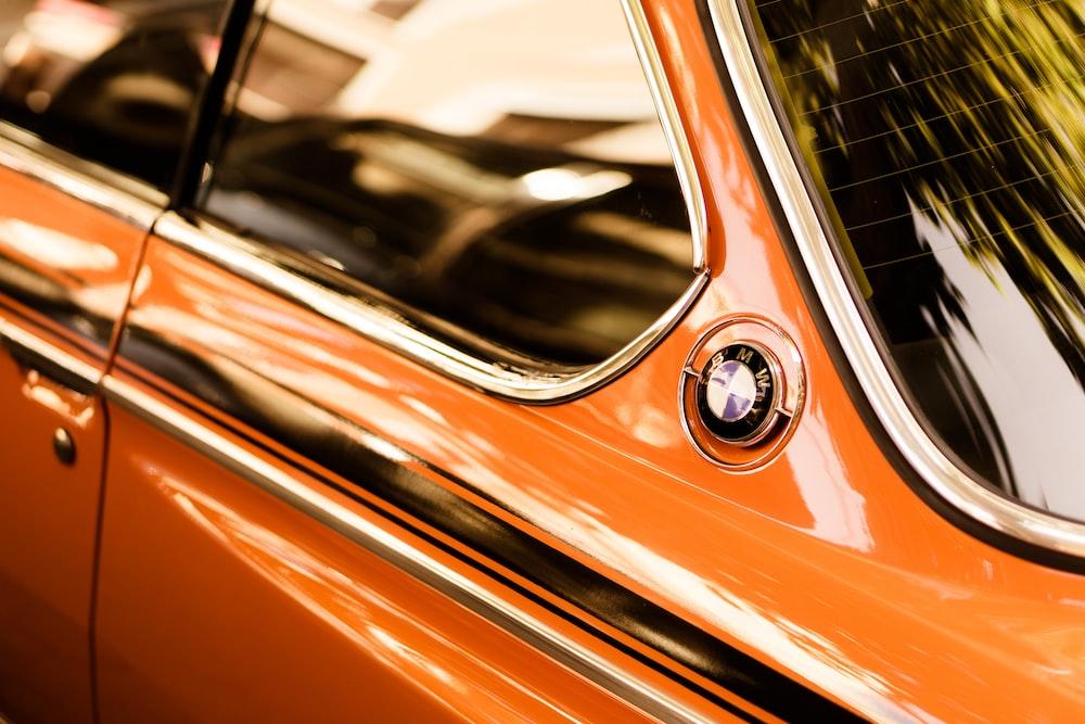 time lapse photography of orange BMW car