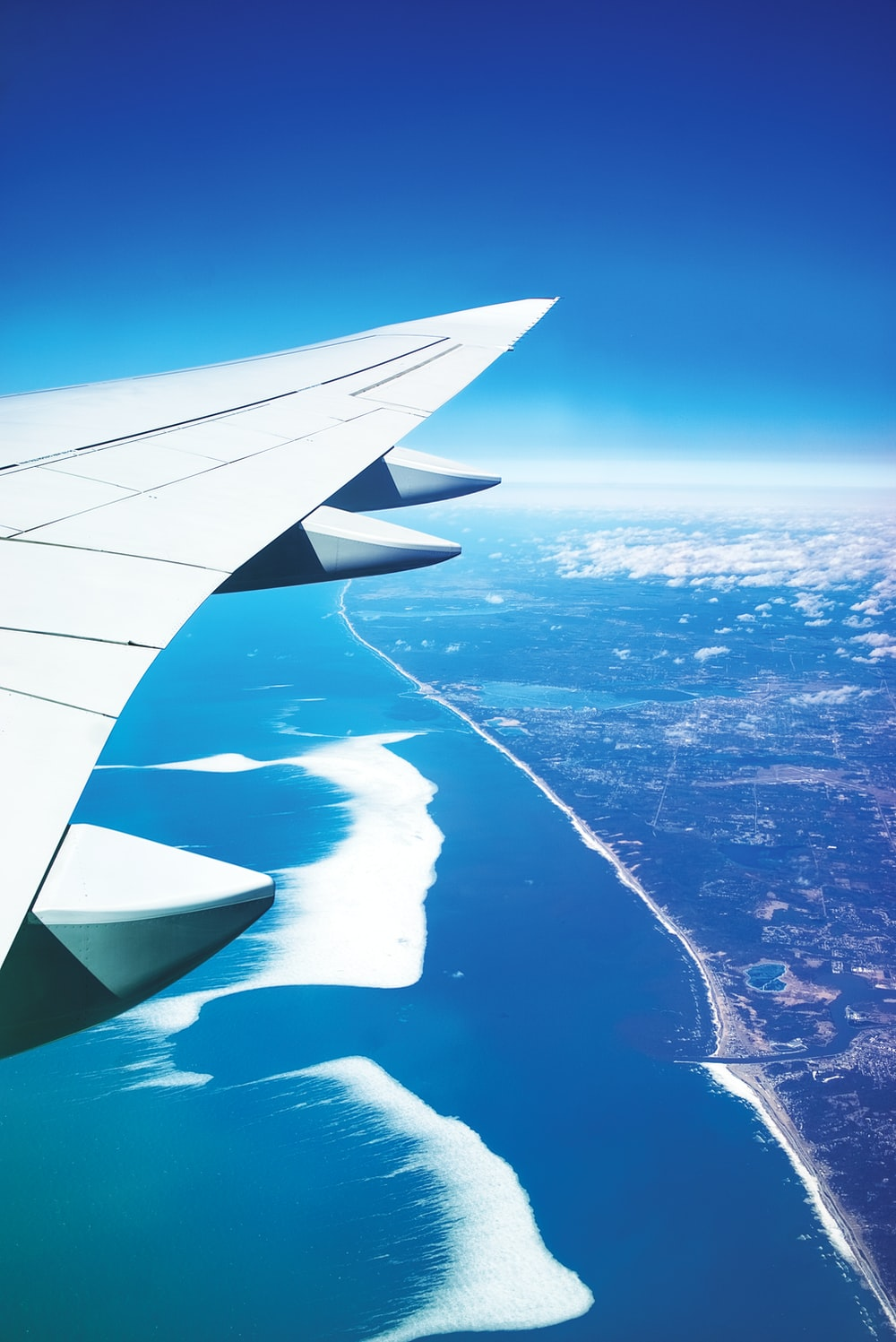 aerial photo of airplane wings during daytime