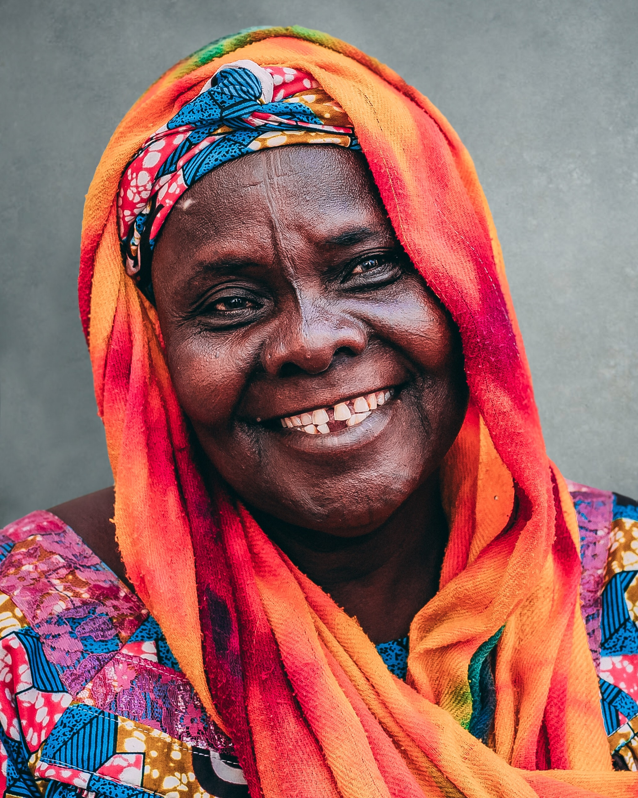 selective focus photography of woman wearing orange scarf