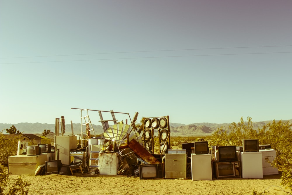 home appliance in the middle of the desert during daytime