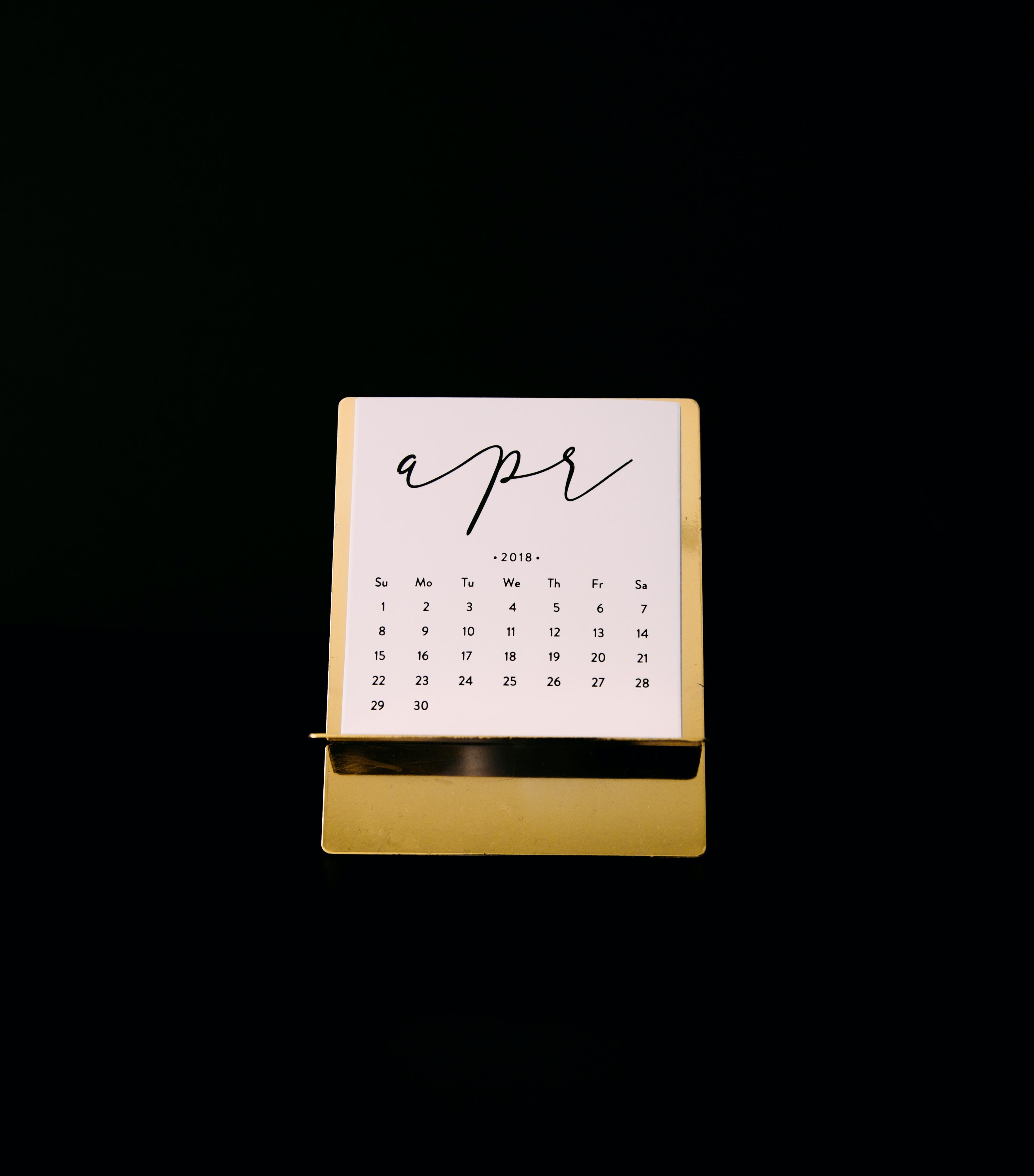 white calendar on brown rack