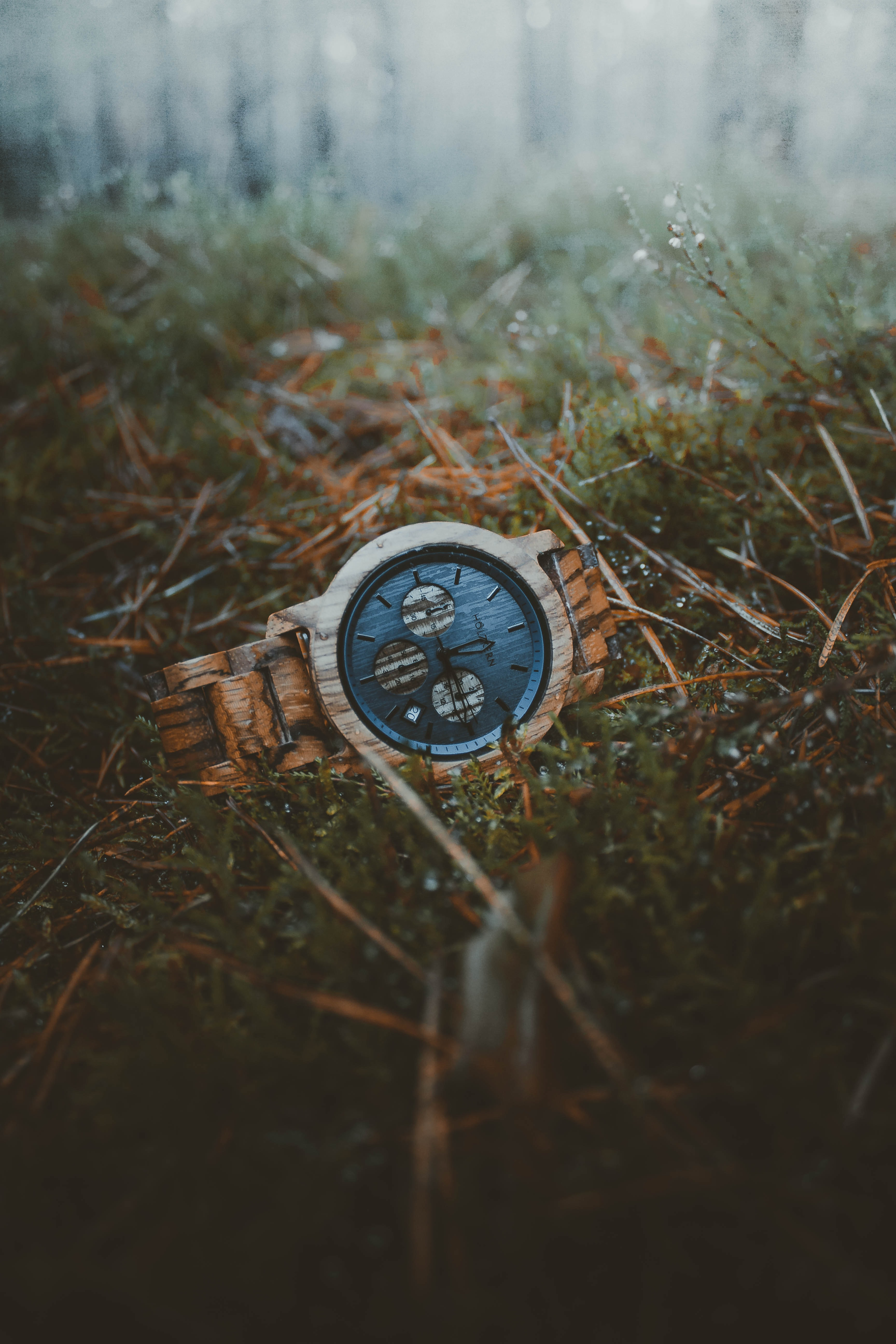 selective focus photography of watch on grass field