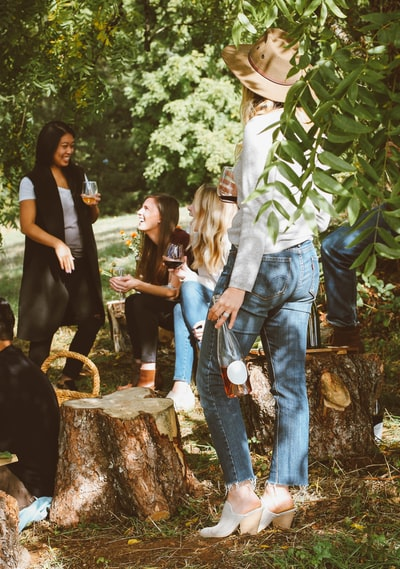 group of women in forest drinking