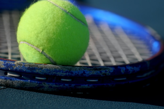 green tennis ball in closeup photography