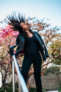 standing woman doing hair flick