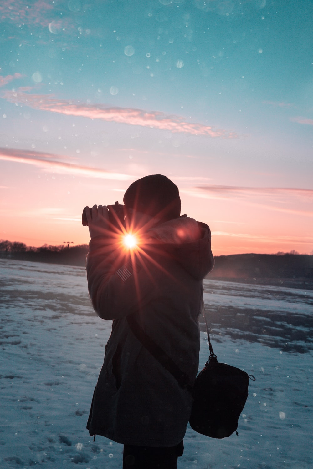 person holding DSLR camera taking photos