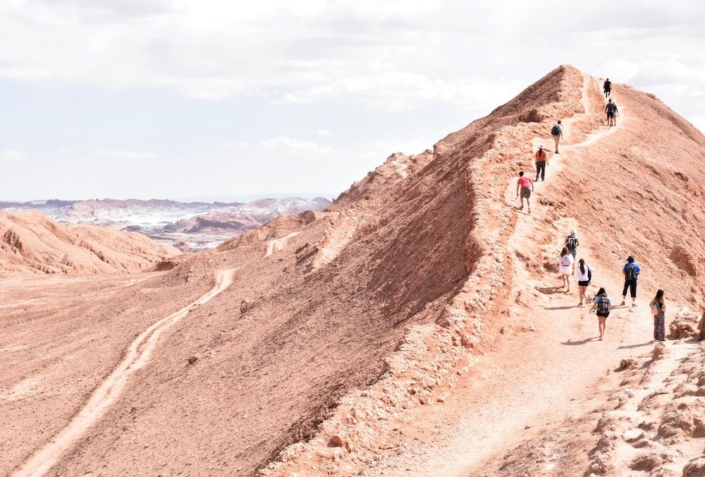 people walking at the mountain
