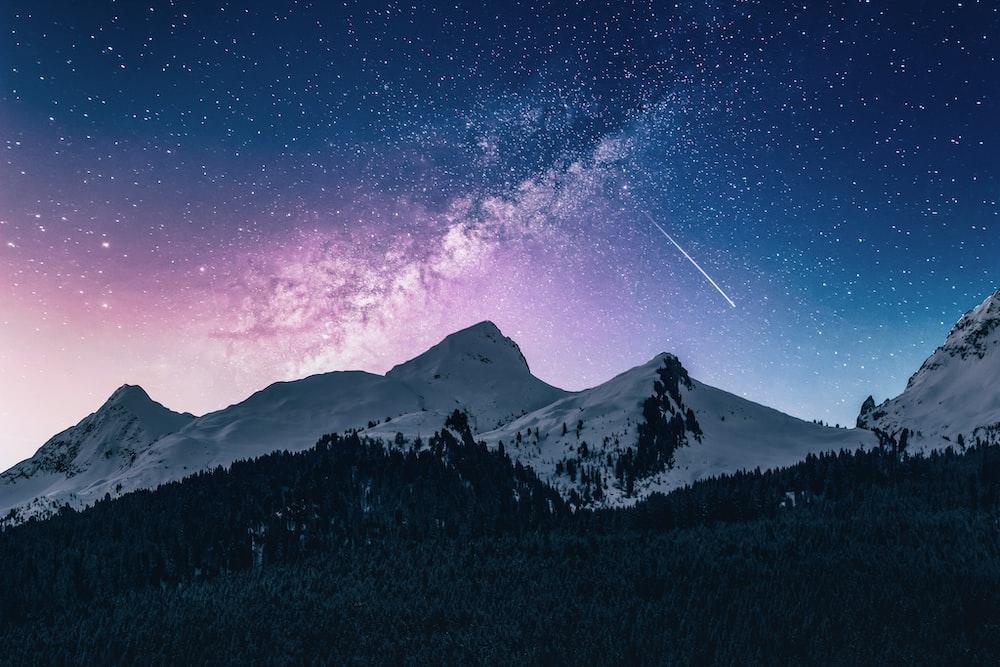 snow mountain under stars