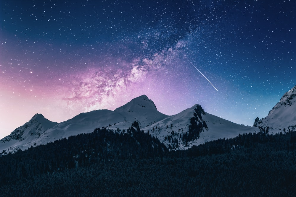snow mountain under stars
