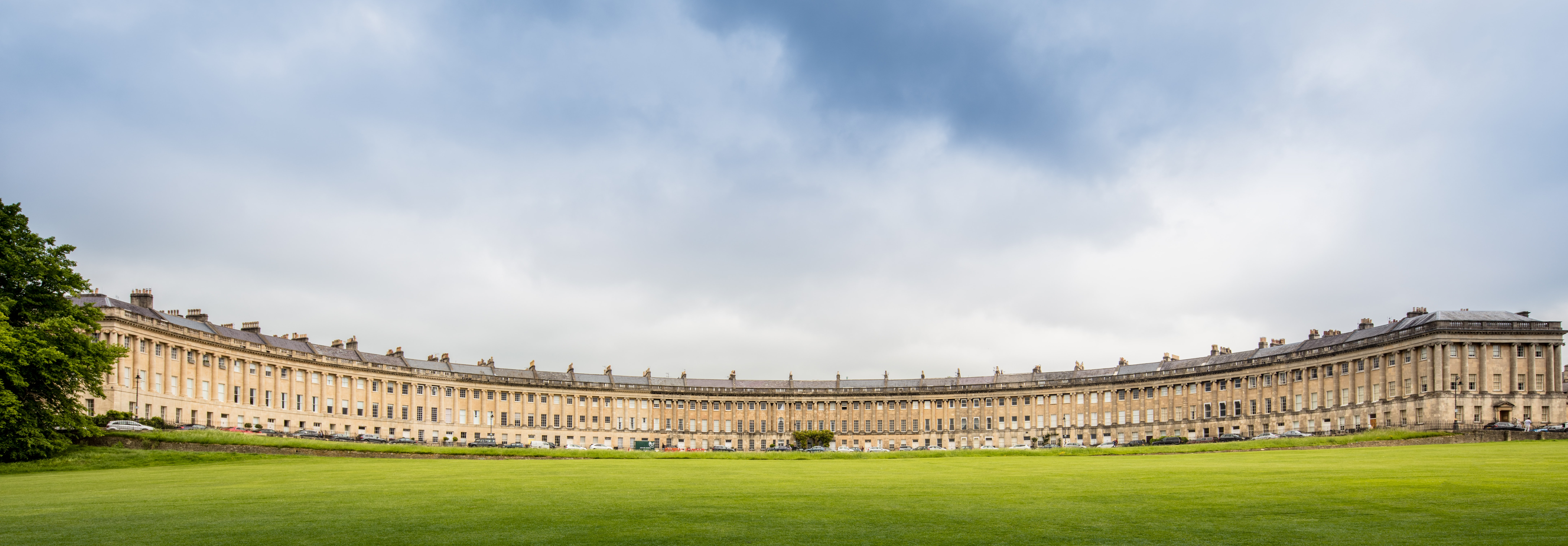 landscape photo of green lawn grass in front of historical building