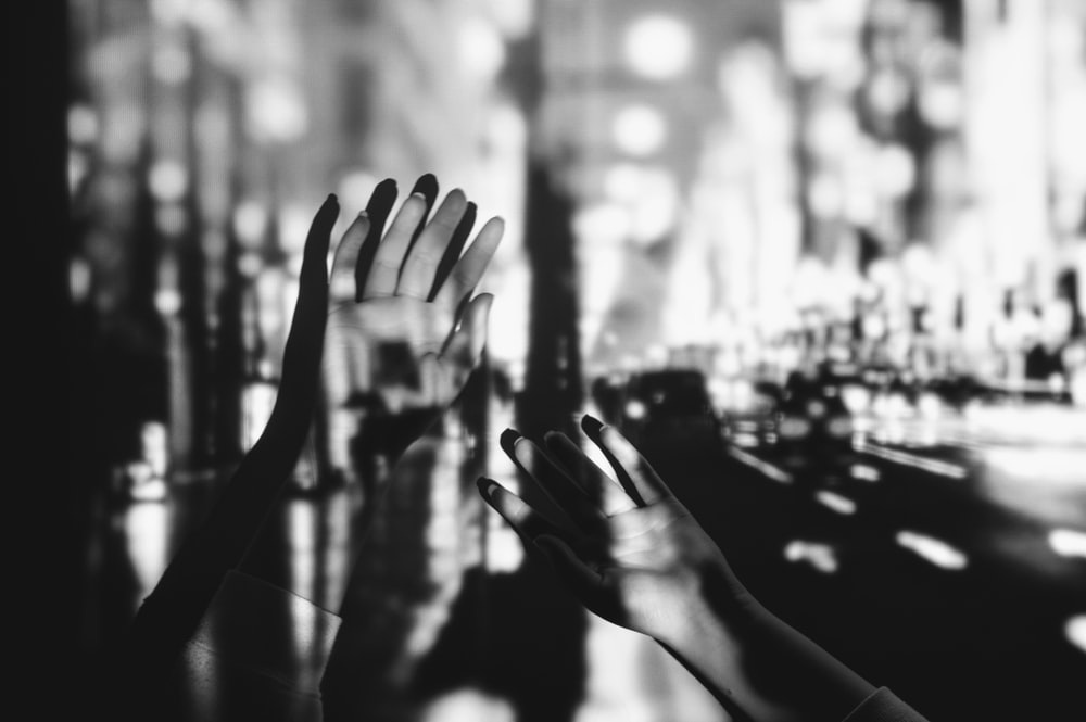 grayscale photography of person's hands