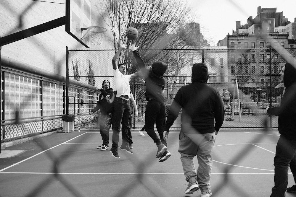 grayscale photo of group of men playing street basketball photo – Free  Basketball Image on Unsplash