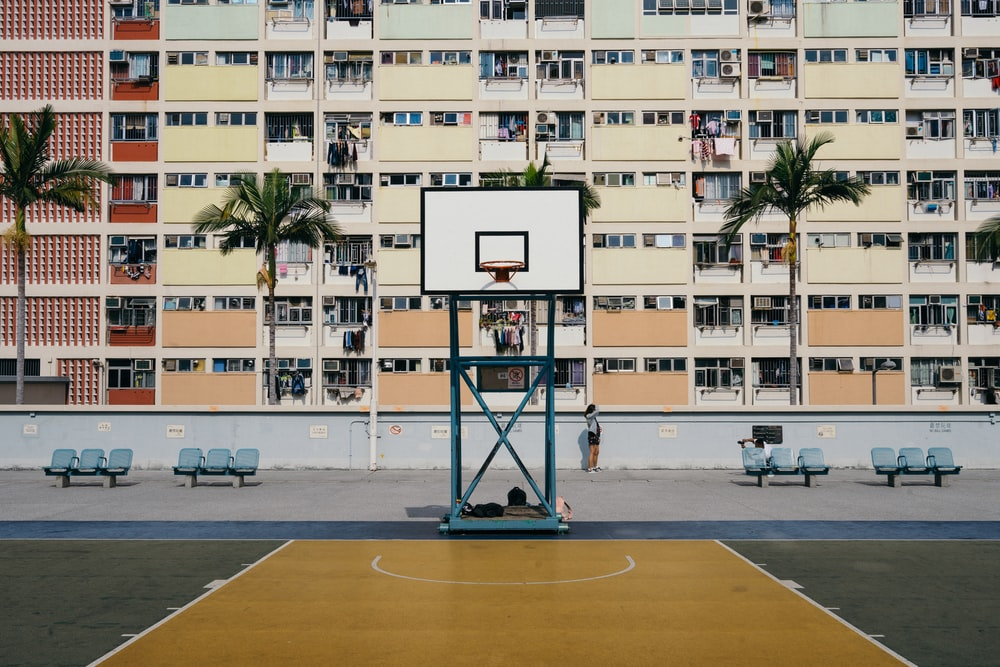 basketball court against tenement